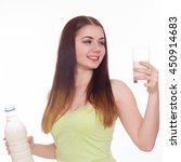 young woman is drinking milk | Shutterstock . vector #450914683