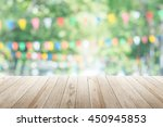 empty wooden table with party... | Shutterstock . vector #450945853