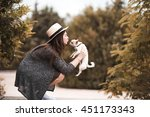 Stock photo stylish woman kissing puppy chihuahua outdoors in park togetherness friendship s 451173343