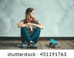 teenager girl with skateboard... | Shutterstock . vector #451191763