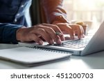 businessman s hands typing on
