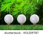 three golf ball on tee pegs in... | Shutterstock . vector #451209787