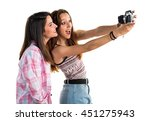 friends photographing | Shutterstock . vector #451275943