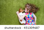 Stock photo little girl embracing puppy jack russell high top view 451309687