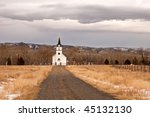a small country church and cemetery in the mountains of Montana
