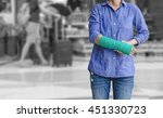 injured woman with green cast...   Shutterstock . vector #451330723