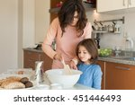 mother and daughter cooking in... | Shutterstock . vector #451446493