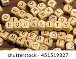 equality word written on wood... | Shutterstock . vector #451519327