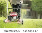 grass cutting with lawn mower | Shutterstock . vector #451681117