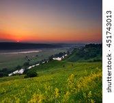 sunrise on a hillside | Shutterstock . vector #451743013