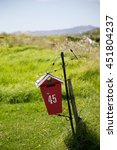 Bright Red Letter Box In Rural...