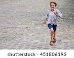 Boy Running In The Street.