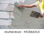 mason plastering the concrete... | Shutterstock . vector #451866313