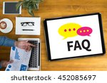 Small photo of FAQ abbreviation ( frequently asked questions ) Businessman working at office desk and using computer and objects, coffee, top view
