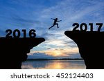 man jump through the gap... | Shutterstock . vector #452124403