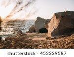 shoreline rocks at sunset near... | Shutterstock . vector #452339587