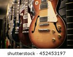 Row Of Guitars On Display For...