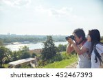 young asian tourists taking a... | Shutterstock . vector #452467393