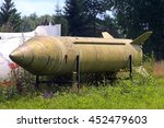 Small photo of MOSCOW, RUSSIA - CIRCA JULY, 2016: SCUD R-11 R-17 R-300 tactical soviet russian ballistic missile lying on grass with all service markings close up detail exterior view
