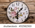 Wall Clock Isolated On A Woode...