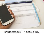 hand holding mobile phone... | Shutterstock . vector #452585407