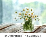Chamomile Bouquet On Wooden...