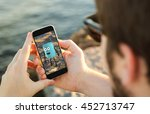 man on the coast using his... | Shutterstock . vector #452713747