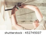 man making mount for electrical ... | Shutterstock . vector #452745037