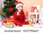 happy little boy in santa hat... | Shutterstock . vector #452790667