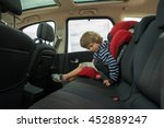 little boy fasten seat belt in... | Shutterstock . vector #452889247