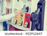 woman hand swiping credit card... | Shutterstock . vector #452912647