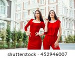 two beautiful young brunette... | Shutterstock . vector #452946007