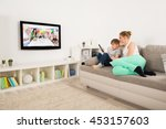 mother and son watching... | Shutterstock . vector #453157603