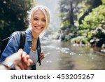 portrait of happy young woman... | Shutterstock . vector #453205267