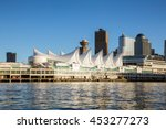 Stock photo canada place and commercial buildings in downtown vancouver viewed from water during sunset 453277273