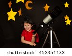 happy boy with a telescope on... | Shutterstock . vector #453351133
