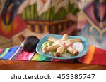 Small photo of Traditional Mexican food taquito platter with avocado with copy space