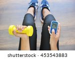 girl holding dumbbell and... | Shutterstock . vector #453543883