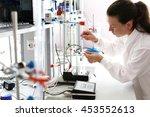 girl chemist working in a... | Shutterstock . vector #453552613