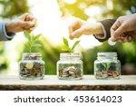 businessman hands putting money ... | Shutterstock . vector #453614023