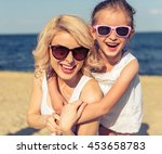 portrait of beautiful young mom ... | Shutterstock . vector #453658783
