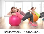 Young Women Doing Exercise Wit...