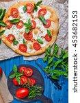 pizza margherita on dark wooden ... | Shutterstock . vector #453682153