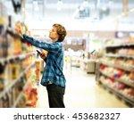 man shopping in supermarket...   Shutterstock . vector #453682327