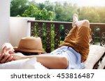 Rear View Of Asian Man Relaxin...