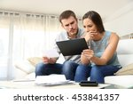 worried couple checking bank... | Shutterstock . vector #453841357