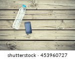 water bottle with phone on wood ... | Shutterstock . vector #453960727