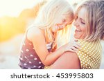 mom playing with her child... | Shutterstock . vector #453995803