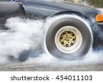 Drag Racing Car Burns Rubber...