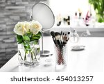 cosmetic brushes with bouquet... | Shutterstock . vector #454013257